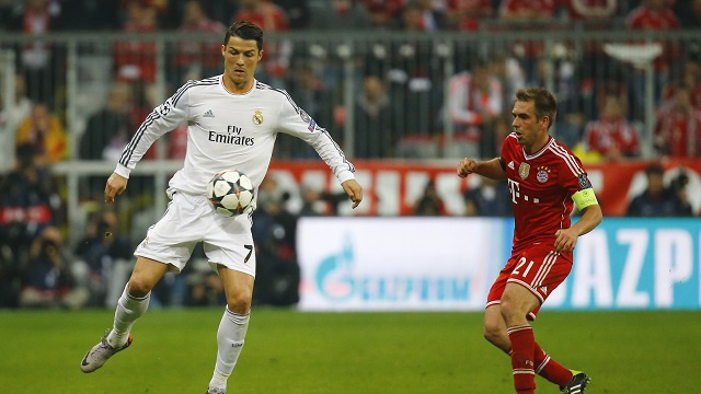 Real Madrid's Cristiano Ronaldo controls the ball next to Bayern Munich's Philipp Lahm during their Champions League semi-final second leg soccer match in Munich