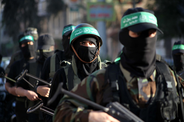 Palestinian members of al-Qassam brigades, the armed wing of the Hamas movement, take part in an anti-Israel parade