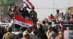 رفع العلم العراقي فوق جسر ناحية الكرمة شمال الفلوجة