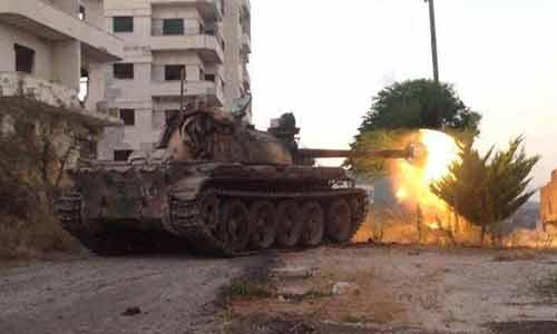 ]دبابة سورية يوضعية الرماية في درعا
