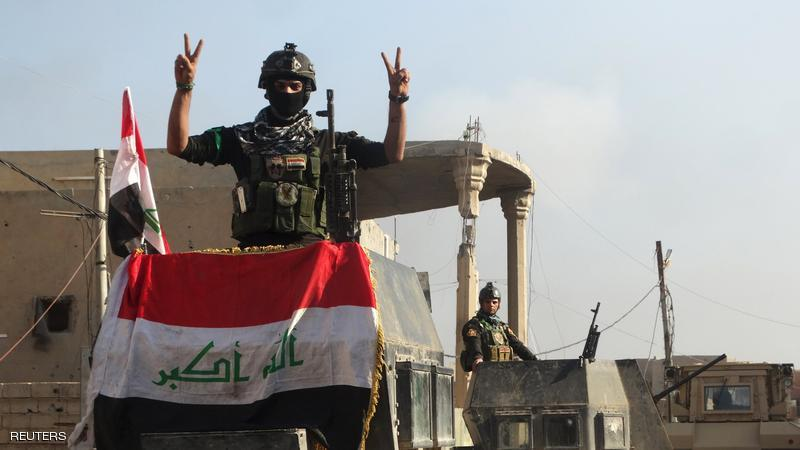 A member of the Iraqi security forces gestures at a government complex in the city of Ramadi, December 28, 2015. REUTERS/Stringer  EDITORIAL USE ONLY. NO RESALES. NO ARCHIVE