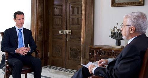 الرئيس بشار الأسد خلال مقابلة مع التلفزيون البرتغالي