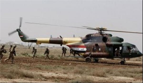 القوات الامنية العراقية تنفذ انزالا جويا في أيمن الموصل وتنصب جسرين عائمين