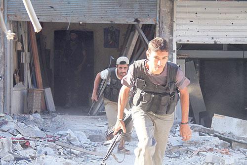 """مصادر معارضة: مخيم اليرموك يدخل تسوية """"البلدات الأربع"""""""