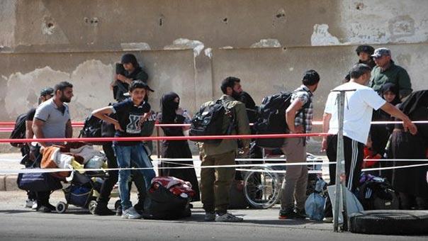 تناقص أعداد الرافضين لاتفاق المصالحة بعد خروج 260 مسلحا من حي الوعر في حمص