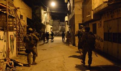 جيش الاحتلال الإسرائيلي يعتقل 12 فلسطينياً بالضفة الغربية